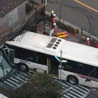 Driver hurt after deadheading bus steers wild course, slams into apartment building
