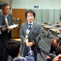 Hosei University professor Naoki Ogi speaks to reporters Tuesday at the Diet about the Jan. 15 bus crash in Karuizawa, Nagano Prefecture, that killed four of his students. | KYODO