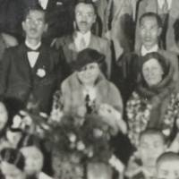 A close-up of a photo shows Helen Keller with students and teachers at Gifu Prefectural School for the Blind in the city of Gifu in June 1937. | COURTESY OF GIFU PREFECTURAL SCHOOL FOR THE BLIND / CHUNICHI SHIMBUN