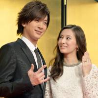 Singer Daigo and actress Keiko Kitagawa pose for photos after announcing their marriage at a news conference in Tokyo on Monday. | KYODO
