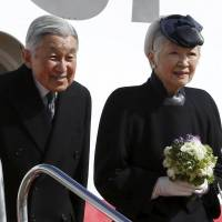Emperor Akihito and Empress Michiko board a special flight Tuesday at Tokyo's Haneda airport for their visit to the Philippines. | REUTERS