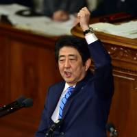 Prime Minister Shinzo Abe delivers a speech to the Lower House last Wednesday. | AFP-JIJI