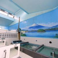 Japan's public baths hope foreign tourists will help keep the taps running