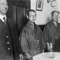 Convicted military police officer Masahiko Amakasu (center) attends a press conference on Nov. 3, 1926, in Tokyo to discuss his killing of anarchists. | X JAPAN TELEGRAPHIC COMMUNICATION CO. / KYODO