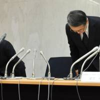 Hokkaido University officials, including Vice President Kazunori Yasuda, bow in apology at its campus in Sapporo on Wednesday over a suspected massive leak of students' personal information.   KYODO