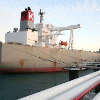 A tanker filled with crude oil for exports apparently to Japan is docked at a port in Iran's Kharg Island on Tuesday. | IRAN'S MINISTRY OF PETROLEUM / KYODO