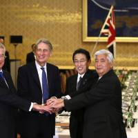 British Defense Secretary Michael Fallon (left), Foreign Secretary Philip Hammond and Japanese counterparts Foreign Minister Fumio Kishida and Defense Minister Gen Nakatani shake hands before their 'two-plus-two' meeting at the Iikura guest house in Tokyo on Friday. | REUTERS