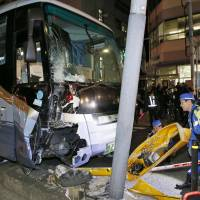 24 hurt in Tokyo tour bus crash; driver, 58, says he was 'absent-minded'