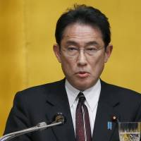 Foreign Minister Fumio Kishida delivers an address on Japanese foreign policy for 2016 at the Japan Institute of International Affairs Forum in Tokyo on Tuesday. | AP