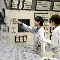 Workers attend a training session to deal with emergencies at the Monju prototype fast-breeder nuclear reactor in Tsuruga, Fukui Prefecture. | KYODO
