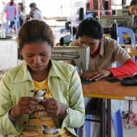 Women make various products with sewing machines at the Community Factory in Sout Nikom in northwestern Cambodia in this undated photo. | COURTESY OF KAMONOHASHI PROJECT