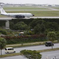 A U.S. Air Force RC-135S Cobra Ball reconnaissance plane returns to Kadena Air Base in Okinawa on Thursday, a day after North Korea said it conducted a hydrogen bomb test. | AP