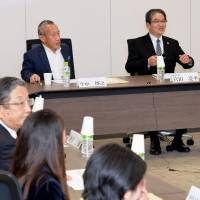 The 2020 Tokyo Olympic Games organizing committee's emblem selection panel holds a session Saturday in Tokyo's Minato Ward. The panel chose four finalists for the logo out of 14,599 proposals. | KYODO