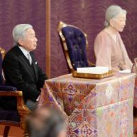 In annual poem, Emperor recalls trip to Palau to mourn war dead