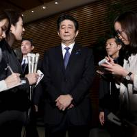 Prime Minister Shinzo Abe speaks to reporters in Tokyo on Thursday. | REUTERS