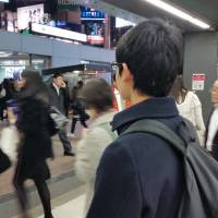 Akira, a 19-year-old university student in Tokyo, says he is interested in romance, but he won't 'go out of my way' to approach girls. | TOMOHIRO OSAKI