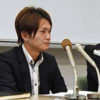 A 23-year-old man from the city of Kagoshima (left), who has requested the media withhold his name, attends a news conference Tuesday in the city of Miyazaki after the Fukuoka High Court's Miyazaki branch cleared him of raping a teenage girl in 2012, reversing a lower court ruling.   KYODO