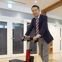 Robot Assist Walker RT. 1, developed by Osaka-based RT. Works Co., is an autonomous electric cart that helps people walk outdoors. | KYODO