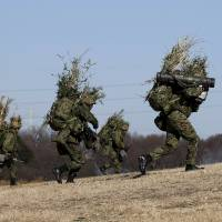 Ground Self-Defense Force members from the 1st Airborne Brigade take part in an annual military exercise at Narashino exercise field in Funabashi, Chiba Prefecture, on Jan. 10. | REUTERS