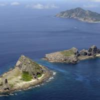 The three Senkaku islets Japan effectively nationalized in 2012 — Minamikojima (left), Kitakojima (center) and Uotsuri — are seen in a photo taken that September. | KYODO