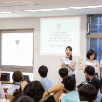Asuka Someya delivers a lecture about safe sex in front of young people as part of a distance-learning course conducted at a high school in Tokyo. | COURTESY OF ASUKA SOMEYA