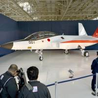 A prototype of the first Japan-made stealth fighter is shown to the media Thursday at a Mitsubishi Heavy Industries Ltd. factory in Aichi Prefecture. | KYODO