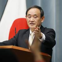 Chief Cabinet Secretary Yoshihide Suga holds a news conference in Tokyo on Tuesday. | KYODO