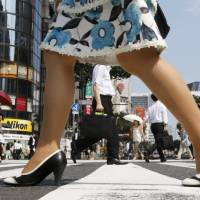 Pedestrians crowd Tokyo's Ginza shopping district in this file photo. | REUTERS