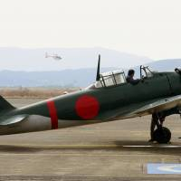 A renovated Zero fighter prepares for flight Wednesday at an MSDF air base in Kanoya, Kagoshima Prefecture. | KYODO