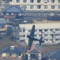 A renovated Zero fighter flies over the city of Kanoya, Kagoshima Prefecture, on Thursday. | KYODO