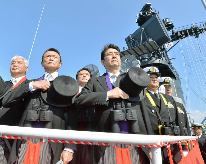 Left to right: Defense Minister Gen Nakatani, Deputy Prime Minister Taro Aso and Prime Minister Shinzo Abe attend a Maritime Self-Defense Force fleet review in October off the coast of Kanagawa Prefecture.