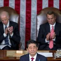 Prime minister Shinzo Abe addresses a joint meeting of Congress with U.S. House Speaker John Boehner and Vice President Joseph Biden in Washington on April 29. | BLOOMBERG