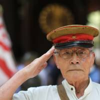 A former soldier salutes at Yasukuni Shrine in Tokyo on Aug. 15, the 70th anniversary of Japan's World War II defeat. | BLOOMBERG