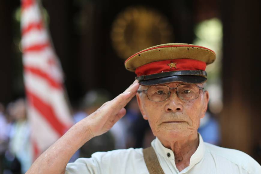 A former soldier salutes at Yasukuni Shrine in Tokyo on Aug. 15, the 70th anniversary of Japan