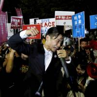 SEALDs founder Aki Okuda leads a protest in September in front of the Diet against new security legislation. | REUTERS