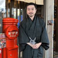 History buff: Postal system expert Yosuke Naito says people sent New Year's cards in the postwar years to confirm whether or not relatives survived. | YOSHIAKI MIURA