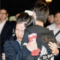Former inmate  Keiko Aoki is reunited with her son after being released in October 2015. | KYODO