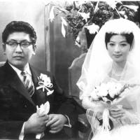 Oshima and Akiko Koyama pose for a photograph at their wedding in Tokyo in 1960. | OSHIMA PRODUCTIONS