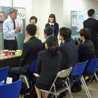 On the hunt: The Tokyo Chamber of Commerce and Industry holds briefing sessions for young job seekers in Minato Ward, Tokyo, in November. | KYODO