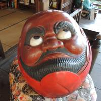 A large Daruma (dharma doll) is displayed at the Daisho-in Temple. | DAVEY YOUNG
