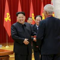 Science fair: North Korean leader Kim Jong Un attends a ceremony to honor nuclear scientists, technicians and soldier-builders. Japan's weeklies have been considerably less happy about these achievements. | REUTERS