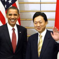 Loving the 'alien': Yukio Hatoyama waves as he shakes hands with U.S. President Barack Obama ahead of their meeting at the prime minister's official residence in Tokyo in November 2009. | BLOOMBERG