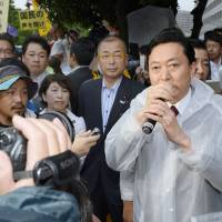 Rebel rebel: Former PM Yukio Hatoyama speaks at an anti-nuclear demonstration outside the prime minister's official residence in Tokyo in July 2012. | KYODO