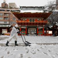 Snow way! Tokyo residents surprised by heavy snowfall