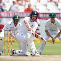 England's Benjamin Stokes (center) plays a shot before getting caught out during the fifth day of the second test between England and South Africa on Wednesday at Newlands stadium in Cape Town. | AFP-JIJI