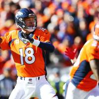 Broncos quarterback Peyton Manning drops back to pass during the AFC title game on Sunday in Denver. | USA TODAY / REUTERS