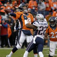 Broncos quarterback Peyton Manning makes a pass while under pressure from Patriots cornerback Justin Coleman during the AFC title game on Sunday in Denver. | AP