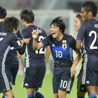 Shoya Nakajima (10) notched a pair of extra-time goals as Japan defeated Iran 3-0 in the quarterfinals of the Asian Under-23 Championships on Friday in Doha. | KYODO
