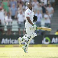 South African batsman Temba Bavuma celebrates after scoring a century against England on Tuesday in Cape Town. | AFP-JIJI