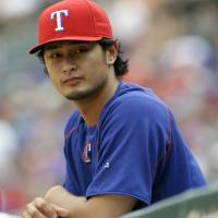Texas Rangers pitcher Yu Darvish says he has never been involved in gambling activities following the arrest of his younger brother. | AP